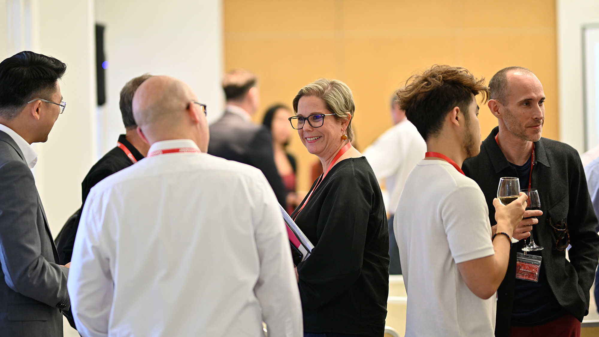 Gensler Singapore Co-Managing Director Angela Spathonis mingles with the crowd.