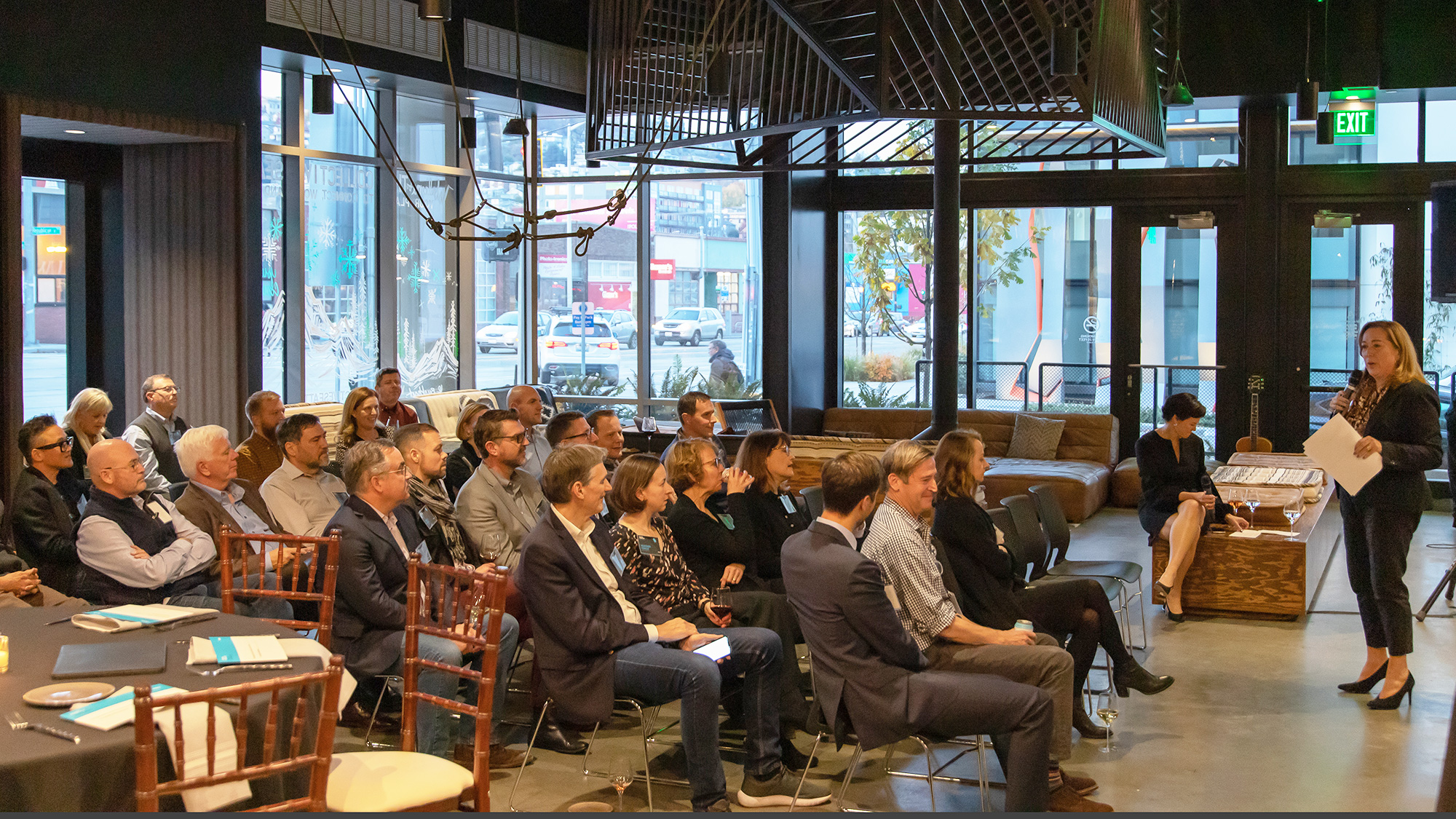 A crowd listens to the keynote address for Gensler Cascadia's Design Forecast Local event.