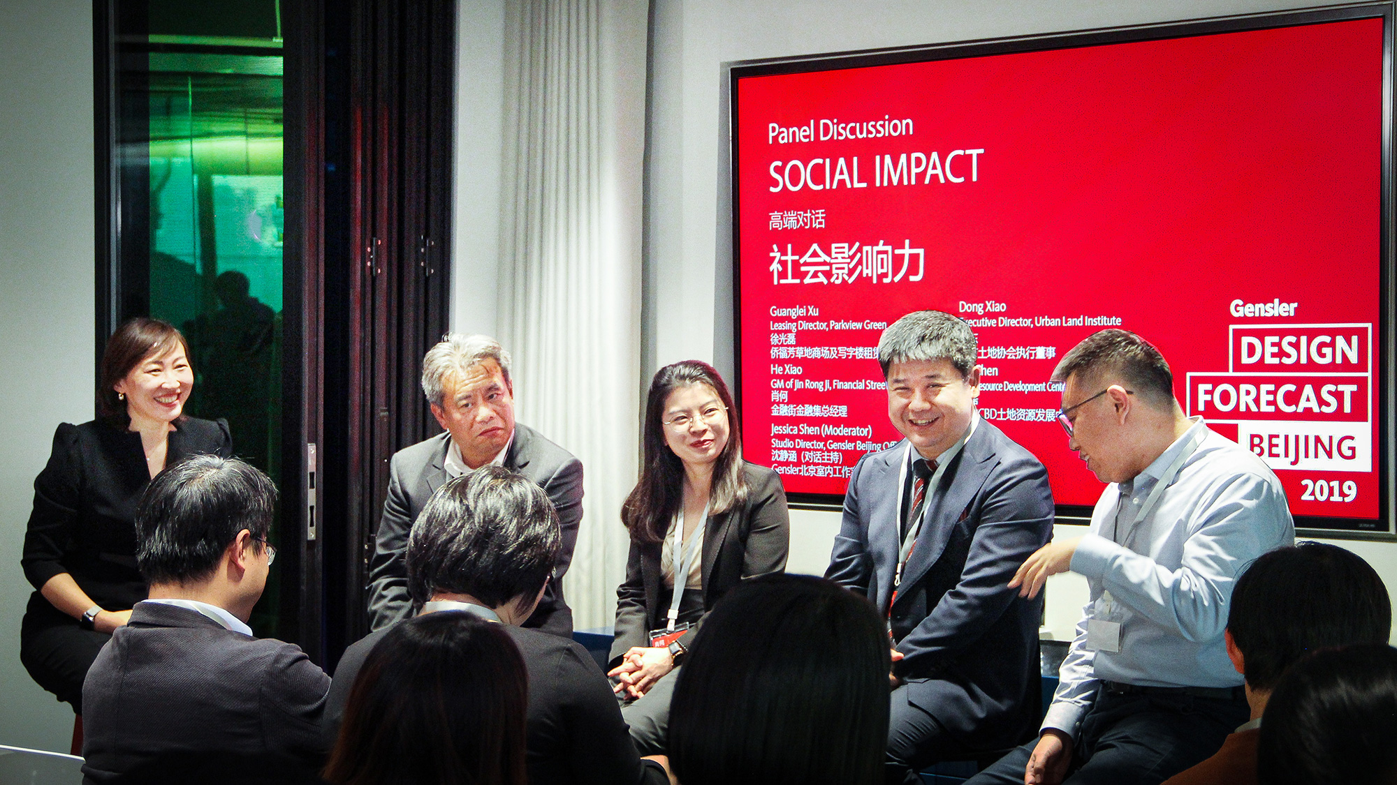 Panelists discuss the topic of social impact